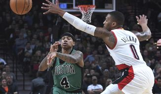 Boston Celtics guard Isaiah Thomas passes the ball past Portland Trail Blazers guard Damian Lillard during the first half of an NBA basketball game in Portland, Ore., Thursday, Feb. 9, 2017. (AP Photo/Steve Dykes)