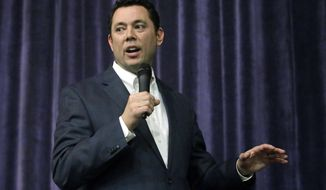 Rep. Jason Chaffetz speaks during a town hall meeting at Brighton High School, Thursday, Feb. 9, 2017, in Cottonwood Heights, Utah. Hundreds of people lined up early for a town hall with Chaffetz on Thursday evening, many holding signs criticizing the congressman's push to repeal the newly-named Bears Ears National Monument in southern Utah. (AP Photo/Rick Bowmer)
