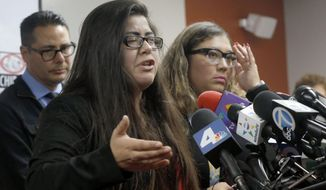 CLARIFIES THAT FATHER HAS NOT BEEN DEPORTED- Marlene Mosqueda, left, who's father was arrested by ICE agents early Friday morning to be deported, talks at a news conference with her Attorney Karla Navarrette at The Coalition for Humane Immigrant Rights of Los Angeles (CHIRLA) on Friday, Feb. 10, 2017. Navarrete, said she sought to stop Mosqueda from being placed on a bus to Mexico and was told by ICE that things had changed. She said another lawyer filed federal court papers to halt his removal. (AP Photo/Nick Ut)
