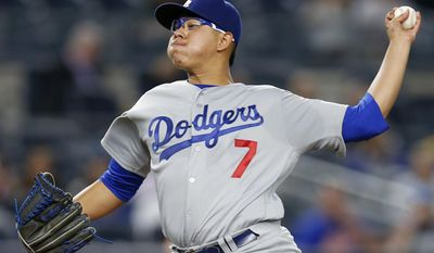 FILE - This Sept. 13, 2016, file photo shows Los Angeles Dodgers' starting pitcher Julio Urias delivering during the first inning of a baseball game against the New York Yankees, in New York. After coming within two games of reaching the World Series, the Los Angeles Dodgers had a simple plan going into the offseason: keep their roster intact and make a couple of additions. Now if they can just stay healthy in 2017 and have youngsters Corey Seager and Julio Urias continue to mature, the Dodgers could be well positioned to challenge the World Series champion Chicago Cubs, who knocked them out in the NL Championship Series. (AP Photo/Kathy Willens, File)