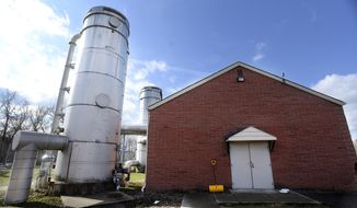 """ADVANCE FOR SATURDAY, FEB. 11, 2017 - This Thursday, Feb. 2, 2017 photo, shows Vanport water department's unique system called """"air strippers"""" which is used to rid the area's water of chemicals, in Vanport, Pa. (Sally Maxson /Beaver County Times via AP)"""