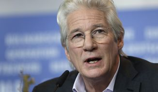 Actor Richard Gere speaks during a press conference for the film 'The Dinner' at the 2017 Berlinale Film Festival in Berlin, Germany, Friday, Feb. 10, 2017. (AP Photo/Michael Sohn)