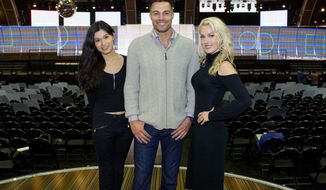 This Feb. 9, 2017 photo shows trophy presenters, from left, transgender model Martina Robledo, actor and model Derek Marrocco, and model and actress Hollin Haley in Los Angeles. The trio will present awards during the 59th Annual Grammy Awards airing live, Sunday, Feb. 12, on CBS. ( Johnny Vy/CBS  via AP)