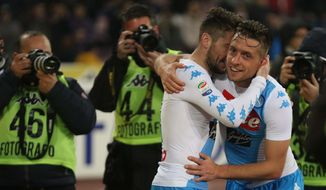 Napoli's midfielder Emanuele Giaccherini, right, celebrates embracing his teammate Dries Martens after scoring a goal during the Italian Serie A soccer match between Napoli and Genoa at the San Paolo stadium in Naples, Italy, Friday, Feb. 10 2017.  (Cesare Abbate/ANSA via AP)
