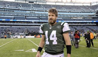 in this Jan. 1, 2017, file photo, New York Jets quarterback Ryan Fitzpatrick walks off the field after the team's NFL football game against the Buffalo Bills in East Rutherford, N.J. (AP Photo/Bill Kostroun, File)