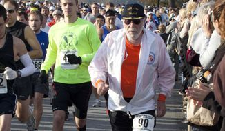 FILE - In this Nov. 14, 2010 file photo, Don McNelly (90), of Irondequoit, N.Y., competes  in the 2010 Harrisburg Marathon in Harrisburg, Pa.  McNelly, an internationally known runner who completed 744 marathons has died, he was 96. The Richard H. Keenan Funeral Home in Fairport, N.Y., says he died Sunday, Feb. 5, 2017.  (AP Photo/Daniel Shaknen)