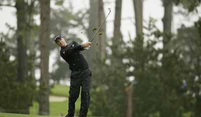 Martin Laird, of Scotland, follows his shot from the 10th fairway of the Spyglass Hill Golf Course during the second round of the AT&T Pebble Beach National Pro-Am golf tournament Friday, Feb. 10, 2017, in Pebble Beach, Calif. (AP Photo/Eric Risberg)