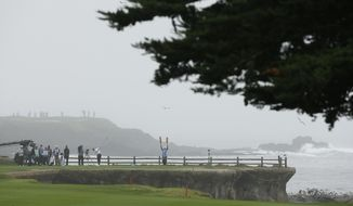 J.T. Poston hits from the 18th tee of the Pebble Beach Golf Links during the second round of the AT&T Pebble Beach National Pro-Am golf tournament Friday, Feb. 10, 2017, in Pebble Beach, Calif. (AP Photo/Eric Risberg)
