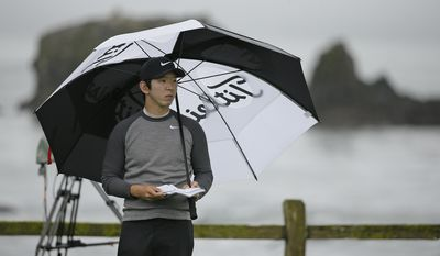 Seung-Yul Noh, of South Korea, waits to hit from the 18th tee of the Pebble Beach Golf Links during the second round of the AT&T Pebble Beach National Pro-Am golf tournament Friday, Feb. 10, 2017, in Pebble Beach, Calif. (AP Photo/Eric Risberg)