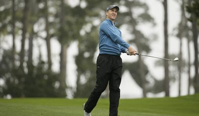 Peyton Manning follows his shot from the 10th fairway of the Spyglass Hill Golf Course during the second round of the AT&T Pebble Beach National Pro-Am golf tournament Friday, Feb. 10, 2017, in Pebble Beach, Calif. (AP Photo/Eric Risberg)