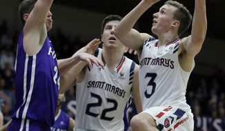 Saint Mary's Emmett Naar, right, shoots against Portland's Gabe Taylor during the second half of an NCAA college basketball game Thursday, Feb. 9, 2017, in Moraga, Calif. (AP Photo/Ben Margot)