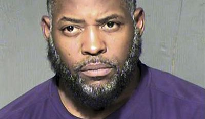 FILE - This undated file photo provided by the Maricopa County Sheriff's Department shows Abdul Malik Abdul Kareem. Court records show an undercover FBI agent who was investigating terrorism was driving past two Arizona men in 2015 just before they opened fire outside a Prophet Muhammad cartoon contest in suburban Dallas. An attorney for Kareem, of Phoenix, convicted of helping plot the shooting says in court records that the agent's presence raises questions about whether authorities could have done more to thwart the attack. (Maricopa County Sheriff's Department via AP, File)