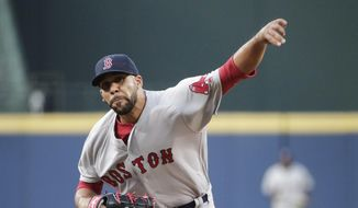 FILE - In this April 26, 2016, file photo, Boston Red Sox starting pitcher David Price throws in the first inning of a baseball game against the Atlanta Braves in Atlanta. Red Sox president of baseball operations Dave Dombrowski plucked lefty Price off the free-agent list before last season. (AP Photo/David Goldman, File)