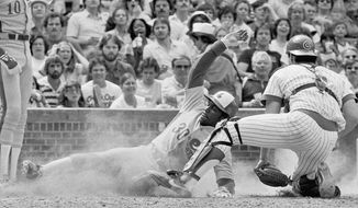 FILE - In this May 23, 1981, file photo, Montreal Expos Tim Raines steals home as Chicago Cubs catcher applies a late tag during the eighth inning of a baseball game in Chicago. The stolen base has been stolen from much of baseball, an afterthought when spring training starts next week. Raines swiped 70 or more each year from 1981-86, among the 808 he accumulated over 23 major league seasons. (AP Photo/Larry Stoddard, File)