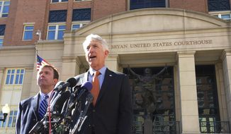 Virginia Attorney General Mark Herring, right, accompanied by Virginia Solicitor General Stuart Raphael, speaks outside the federal courthouse in Alexandria, Va., Friday, Feb. 10, 2017, following a hearing on President Donald Trump's travel ban. (AP Photo/Jessica Gresko) ** FILE **