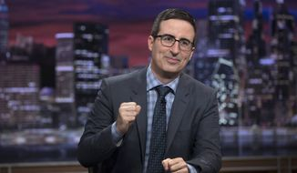 "This image released by HBO shows John Oliver on the set of ""Last Week Tonight with John Oliver."" (Eric Liebowitz/HBO via AP)"