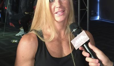 FILE - In this Nov. 13, 2015, file photo, Holly Holm of the U.S. talks about her upcoming UFC bantamweight title match against Ronda Rousey, in Melbourne, Australia. Holly Holm is already the answer to a trivia question as the first fighter to dominate and defeat Ronda Rousey. She's trying these days to avoid another rather dubious fight conversation. (AP Photo Neil Frankland, File)
