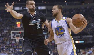 Golden State Warriors guard Stephen Curry (30) drives against Memphis Grizzlies center Marc Gasol (33) during the first half of an NBA basketball game Friday, Feb. 10, 2017, in Memphis, Tenn. (AP Photo/Brandon Dill)