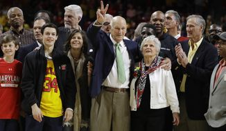 Former Maryland men's basketball coach Lefty Driesell, center, acknowledges fans as he stands with family and former players during a ceremony to commemorate his Terrapins career before an NCAA college basketball game between Maryland and Ohio State, Saturday, Feb. 11, 2017, in College Park, Md. (AP Photo/Patrick Semansky)