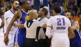 Oklahoma City Thunder center Steven Adams, far left, and Golden State Warriors guard Stephen Curry, far right, help officials Marc Davis (8) and Bennie Adams, center, keep apart Warriors forward Kevin Durant, second from left, and Thunder forward Andre Roberson (21) in the third quarter of an NBA basketball game in Oklahoma City, Saturday, Feb. 11, 2017. (AP Photo/Sue Ogrocki)