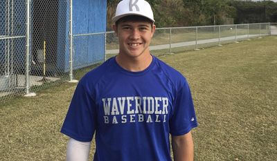 """In this Feb. 7, 2017, photo provided by Josh Hansen, Eli Lai stand on the baseball field at Kealakehe High School in Kailua-Kona, Hawaii. To Oakland Athletics infielder Adam Rosales, he's """"Hawaiian Eli."""" He doesn't even know the teen's last name and hardly remembers the promising shortstop's high school. Yet Eli Lai, his coach and his father will never forget how the kind-hearted major leaguer helped provide a lift to a young man who desperately needed one this winter. He needed an example of how to work. (Josh Hansen via AP)"""
