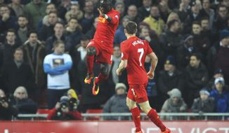 Liverpool's Sadio Mane, left, celebrates scoring his side's first goal during the English Premier League soccer match between Liverpool and Tottenham Hotspur at Anfield, Liverpool, England, Saturday, Feb. 11, 2017. (AP Photo/Rui Vieira)