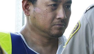 This Aug. 5, 2008, file photo shows Vince Li. Li, who was found not criminally responsible for beheading and cannibalizing a fellow passenger on a Greyhound bus has been granted his freedom. Manitoba's Criminal Code Review Board announced Friday, Feb. 10, 2017,  it has given Will Baker, formerly known as Vince Li, an absolute discharge, meaning he is longer subject to monitoring.  (John Woods/The Canadian Press via AP, File)