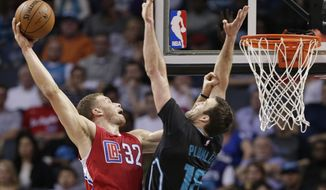 Los Angeles Clippers' Blake Griffin (32) goes up to dunk against Charlotte Hornets' Miles Plumlee (18) in the first half of an NBA basketball game in Charlotte, N.C., Saturday, Feb. 11, 2017. (AP Photo/Chuck Burton)