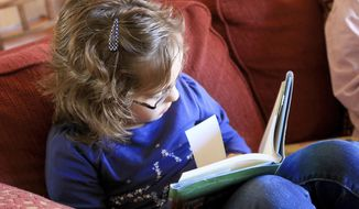 ADVANCE FOR THE WEEKEND OF FEB 11-12 AND THEREAFTER - In a Jan. 27, 2017 photo, Olivia MacKay, 9, reads a book at her home in St. George, Utah. She says her tutor has helped her overcome some of the challenges of dyslexia. (Brian Passey/The Spectrum & Daily News via AP)