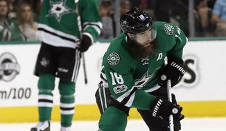 Dallas Stars' Patrick Eaves (18) advances the puck up ice against the Carolina Hurricanes during the third period of an NHL hockey game, Saturday, Feb. 11, 2017, in Dallas. (AP Photo/Mike Stone)