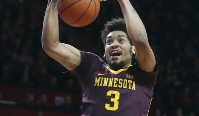 Minnesota forward Jordan Murphy (3) dunks the ball during the first half of an NCAA college basketball game against Rutgers, Saturday, Feb. 11, 2017, in Piscataway, N.J. (AP Photo/Mel Evans)