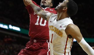 Oklahoma guard Jordan Woodard (10) drives to the basket next to Iowa State guard Nick Weiler-Babb, right, during the first half of an NCAA college basketball game, Saturday, Feb. 11, 2017, in Ames, Iowa. (AP Photo/Charlie Neibergall)