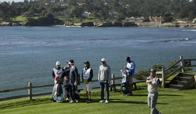 Hockey Hall of Famer Wayne Gretzky, right, follows his shot from the seventh tee of the Pebble Beach Golf Links as playing partner Dustin Johnson, third from right, looks on during the third round of the AT&T Pebble Beach National Pro-Am golf tournament Saturday, Feb. 11, 2017, in Pebble Beach, Calif. (AP Photo/Eric Risberg)