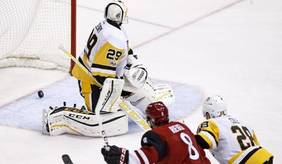 Arizona Coyotes right wing Tobias Rieder (8) beats Pittsburgh Penguins goalie Marc-Andre Fleury (29) and defenseman Ian Cole (28) for a goal during the second period of an NHL hockey game Saturday, Feb. 11, 2017, in Glendale, Ariz. (AP Photo/Ross D. Franklin)
