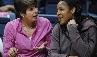 Minnesota Lynx and UConn alumni Maya Moore sits with Connecticut head coach Geno Auriemma's wife Kathy, left, in the second half of an NCAA college basketball game, Saturday, Feb. 11, 2017, in Storrs, Conn. (AP Photo/Jessica Hill)