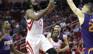 Houston Rockets' James Harden (13) shoots as Phoenix Suns' Alex Len, right, defends during the first half of an NBA basketball game, Saturday, Feb. 11, 2017, in Houston. (AP Photo/David J. Phillip)