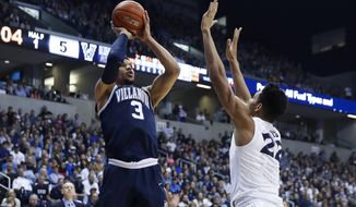 Villanova's Josh Hart (3) shoots over Xavier's Kaiser Gates (22) in the first half of an NCAA college basketball game, Saturday, Feb. 11, 2017, in Cincinnati. (AP Photo/John Minchillo)