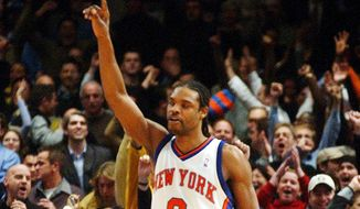 New York Knicks' Latrell Sprewell celebrates after the Knicks defeated the New Jersey Nets, 101-99, Tuesday, Dec. 17, 2002, in New York. (AP Photo/Mark Lennihan) **FILE**