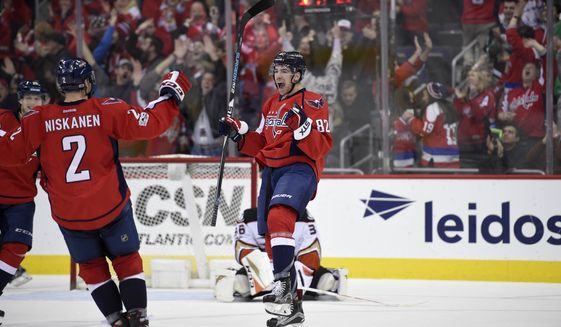 Washington Capitals center Zach Sanford (82) celebrates his goal with Matt Niskanen (2) during the third period of an NHL hockey game as Anaheim Ducks goalie John Gibson, back, looks on Saturday, Feb. 11, 2017, in Washington. This was Sanford's first NHL goal. The Capitals won 6-4. (AP Photo/Nick Wass)
