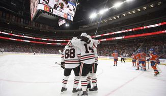 Chicago Blackhawks celebrate a goal against the Edmonton Oilers during the first period of an NHL hockey game Saturday, Feb. 11, 2017, in Edmonton, Alberta. (Jason Franson/The Canadian Press via AP)