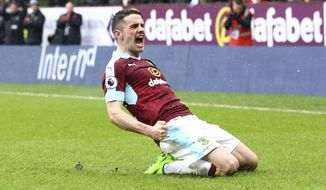 Burnley's Robbie Brady celebrates scoring his side's first goal during the English Premier League soccer match between Burnley and Chelsea at Turf Moor stadium in Burnley, England, Sunday, Feb. 12, 2017. (AP Photo/Dave Thompson)