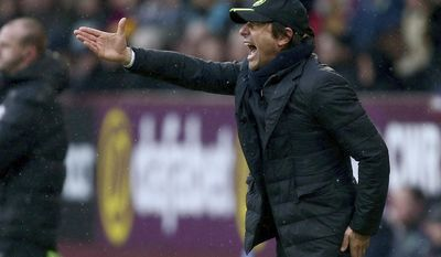 Chelsea's manager Antonio Conte shouts during the English Premier League soccer match between Burnley and Chelsea at Turf Moor stadium in Burnley, England, Sunday, Feb. 12, 2017. (AP Photo/Dave Thompson)