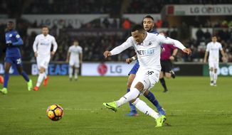 Swansea City's Martin Olsson scores his side's second goal of the game during the English Premier League match Swansea against Leicester at the Liberty Stadium, Swansea, Wales, Sunday Feb. 12, 2017. (Nick Potts/PA via AP)