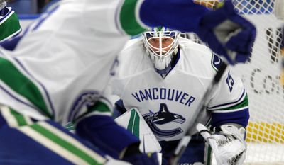 Vancouver Canucks goalie Jacob Markstrom (25) looks through traffic during the first period of an NHL hockey game against the Buffalo Sabres, Sunday, Feb. 12, 2017, in Buffalo, N.Y. (AP Photo/Jeffrey T. Barnes)