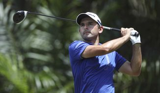 Fabrizio Zanotti of Paraguay watches his shot on the 12th hole during the final day of the Maybank Championship golf tournament in Kuala Lumpur, Malaysia on Sunday, Feb. 12, 2017. (AP Photo/Vincent Thian)