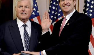 FILE - In this Jan. 6, 2009, file photo, Sen. Edward M. Kennedy, D-Mass., left, holds a Bible during the mock swearing-in ceremony for his son, Rep. Patrick Kennedy, D-R.I., on Capitol Hill in Washington. In a February 2017 interview with the Associated Press, former Rep. Patrick Kennedy speaks about the Donald Trump presidency and what his late father may have thought about it. (AP Photo/Susan Walsh, File)