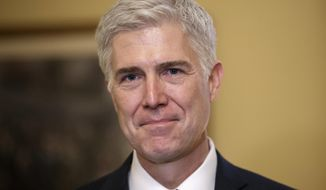 FILE - In this Feb. 1, 2017 file photo, Supreme Court Justice nominee, Neil Gorsuch is seen on Capitol Hill in Washington. Gorsuch has been a defender of free speech and a skeptic of libel claims, an Associated Press review of his rulings shows.  (AP Photo/J. Scott Applewhite, File)