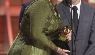 """Adele accepts the award for record of the year for """"Hello"""" at the 59th annual Grammy Awards on Sunday, Feb. 12, 2017, in Los Angeles. (Photo by Matt Sayles/Invision/AP)"""