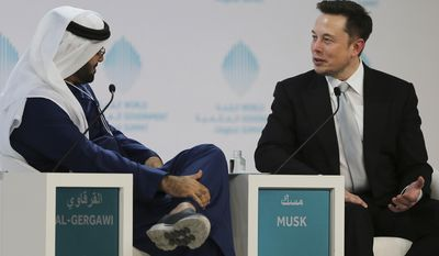 Tesla Motors CEO Elon Musk, right, talks to UAE Minister of Cabinet Affairs, Mohammad Al Gergawi during the second day of the World Government Summit in Dubai, United Arab Emirates, Monday, Feb. 13, 2017. (AP Photo/Kamran Jebreili)
