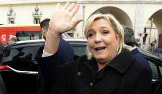 Far-right leader and presidential candidate Marine Le Pen waves as she arrives to pay homage to the 86 victims of an attack last year, Monday Feb. 13, 2017, in Nice, southern France. Le Pen is zeroing in on two of her top priorities, security and immigration, in a visit to southeastern France. (AP Photo/Christian Alminana) ** FILE **